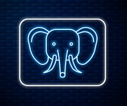 Glowing neon line Elephant icon isolated on brick wall background.  Vector