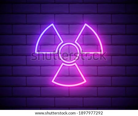 Glowing neon Radioactive icon isolated on brick wall background. Radioactive toxic symbol. Radiation Hazard sign. Vector Illustration. Сток-фото ©