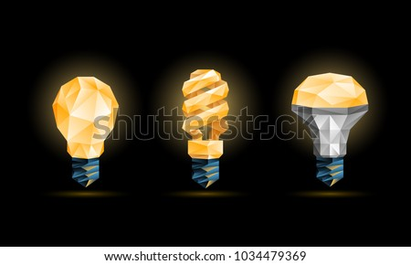 Glowing yellow 3d low poly light bulbs model set. Vector polygonal fluorescent and led bulb illustration on a black background.