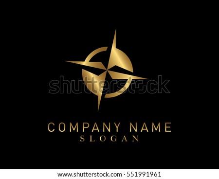gold compass logo