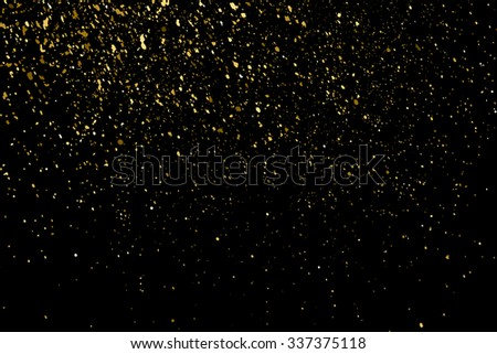 Gold glitter texture on a black background. Holiday background. Golden explosion of confetti. Golden grainy abstract  texture on a black  background. Design element. Vector illustration,eps 10.