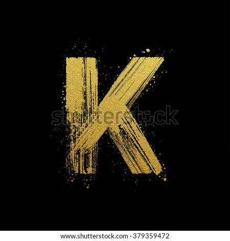Gold glittering letter K in brush hand painted style