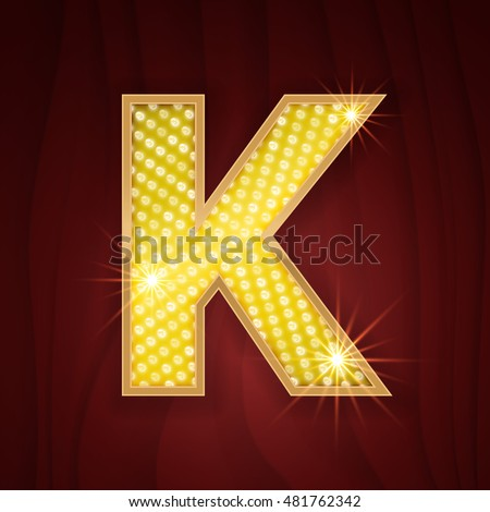 gold light lamp bulb letter k