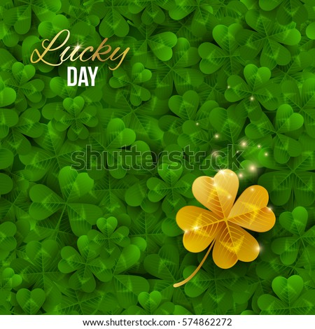 gold shiny four leaf clover on