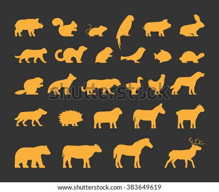 Gold silhouettes set of domestic, farm and wild animals. Icon cow, bear, beaver, sheep, chicken and others.