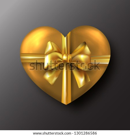 Gold Valentine's day heart with gold bow on black background #1301286586