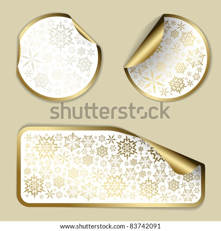 Golden Christmas vector labels and stickers with white border and snowflakes pattern