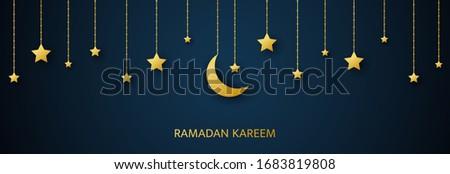 Golden crescent and stars hanging on dark background. Ramadan Kareem arabic banner. Luxury gold design elements for greetings card, poster, invitation. Muslim islamic feast. Vector illustration.