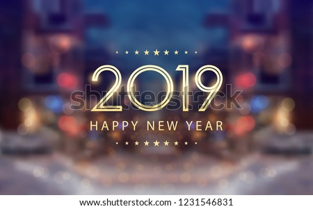 Golden happy new year 2019 with bokeh and lens flare pattern in snowy street at evening background