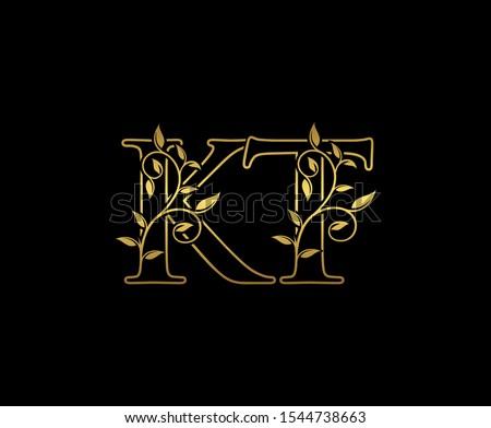 Golden  letter K, T and KT  Vintage Gold Floral Logo Icon, overlapping monogram logo, elegant luxury gold color on black background. CLassy Letter Logo Icon. Stok fotoğraf ©