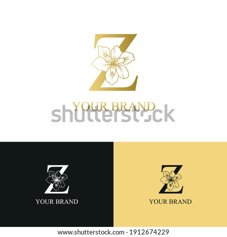 Golden Luxury Initial letter Z with February Iris flower for cosmetic, Jewelry, boutique, hotel, resort, florist, beauty spa salon logo concept vector