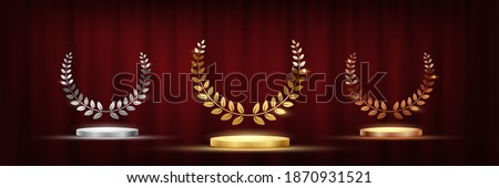 Golden, silver and bronze award signs with podiums laurel wreath isolated on red waving curtain background. Vector award design templates
