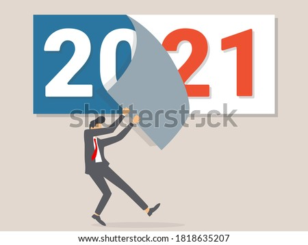 Goodbye 2020. A businessman tears off a calendar sheet of the outgoing year. Parting with coming year.