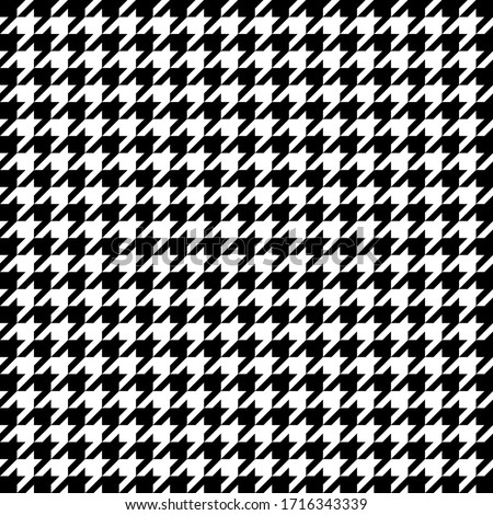 Goose foot. Pattern of crow's feet in black and white cage. Glen plaid. Houndstooth tartan tweed. Dogs tooth. Scottish checkered background. Seamless fabric texture. Vector illustration