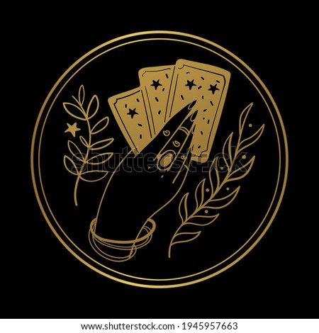 Graceful female hand of a gypsy woman holds tarot cards. Round gold icon on a black background. The concept of divination, witchcraft, fate, card game. Vector illustration isolated on background.