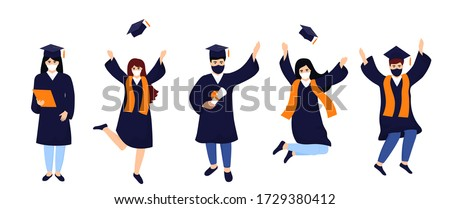 Graduates in protective medical masks celebrate 2020 graduation during coronavirus quarantine. Boys and girls having fun jump and toss up mortarboards and diplomas