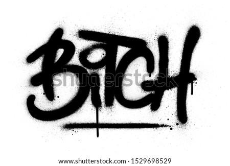 graffiti bitch word sprayed in black over white Stockfoto ©