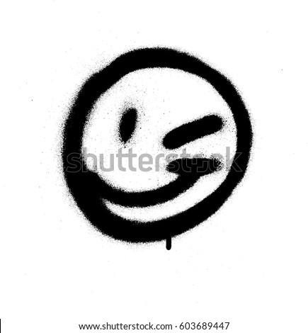 Shutterstock Graffiti emoticon wink face sprayed in black on white