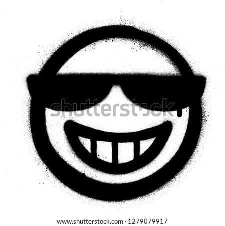 graffiti grin icon with sunglasses sprayed in black over white