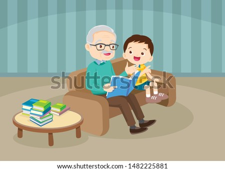 grandparents with grandchildren reading,The grandchildren read books for the grandfather to sit on the sofa to enjoy.Grandfather And Boy Reading A Book