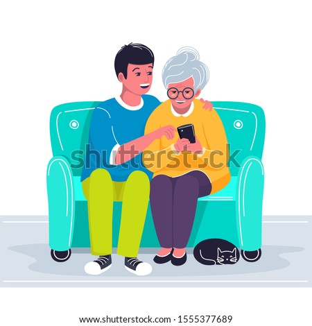 Grandson helping grandmother to use cellphone. Boy showing old woman how to make a call with mobile phone. Two characters sitting on the sofa and holding gadget and cat lying. Vector flat illustration