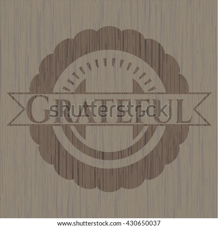 Grateful badge with wooden background