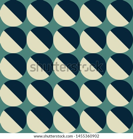 Gray and blue circle. Green background.