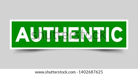 Green and white sticker with word authentic on gray background