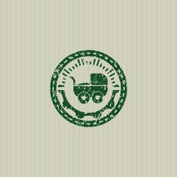 Green baby cart icon inside distress rubber grunge seal