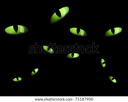 green cat eyes in darkness