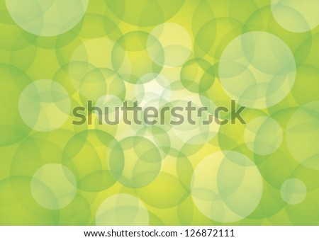 Green circles on white rays of light and bluish background.