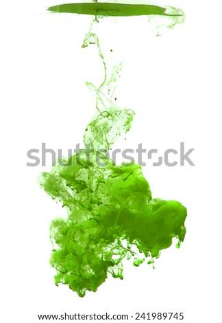 green cloud of ink swirling in