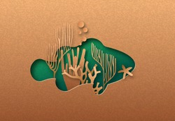 Green clown fish isolated papercut silhouette with tropical coral reef inside. Recycled paper texture tortoise cutout. Wildlife conservation, ocean protection or natural product concept.