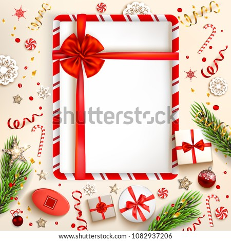 Green fir tree branches on light holiday background. Natural design elements. Festive background with gift boxes