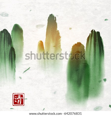 green high mountains in mist on