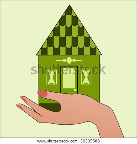 Green house in hand - environment concept