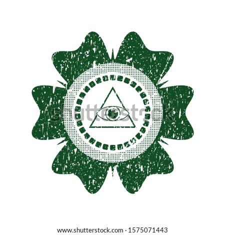 Green illuminati pyramid icon inside rubber seal