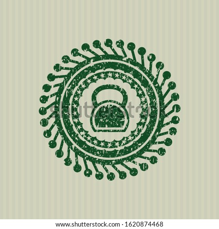 Green kettlebell icon inside distress rubber grunge stamp