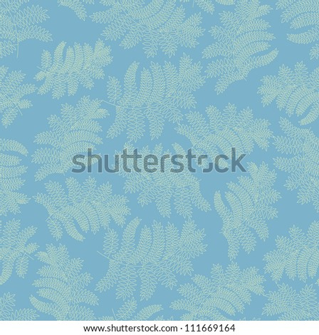 green leaves seamless pattern on blue background