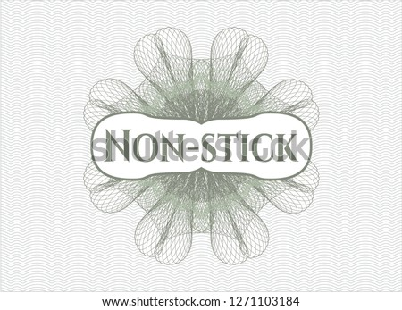 Green money style emblem or rosette with text Non-stick inside
