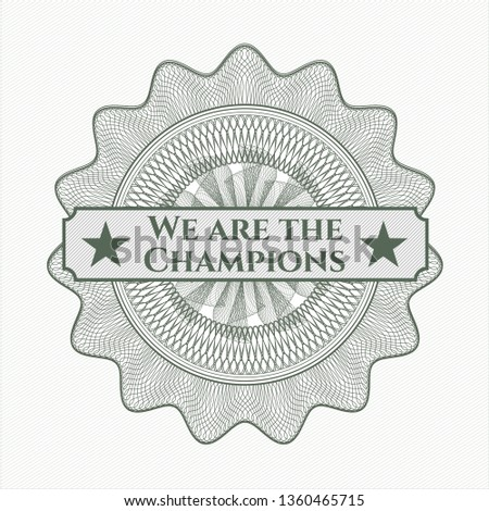 Green money style rosette with text We are the Champions inside