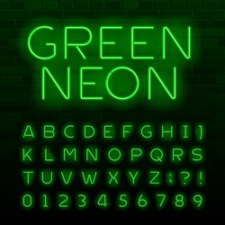Green neon lamp alphabet font. Neon color shiny letters, numbers and symbols. Brick wall background. Stock vector typeface for any typography design.