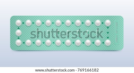 Green packaging of birth control pills. Contraceptive pill, hormonal pills, birth control pills. Women oral contraception. Planning pregnancy concept.Realistic blister with contraceptive pills.