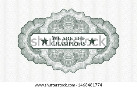 Green passport style rosette with text We are the Champions inside