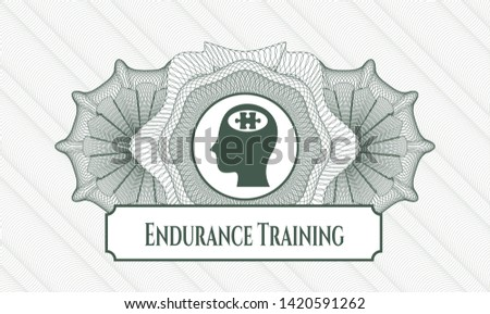 Green rosette (money style emblem) with head with jigsaw puzzle piece icon and Endurance Training text inside