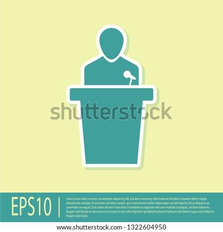 Green Speaker icon isolated on yellow background. Orator speaking from tribune. Public speech. Person on podium. Flat design. Vector Illustration