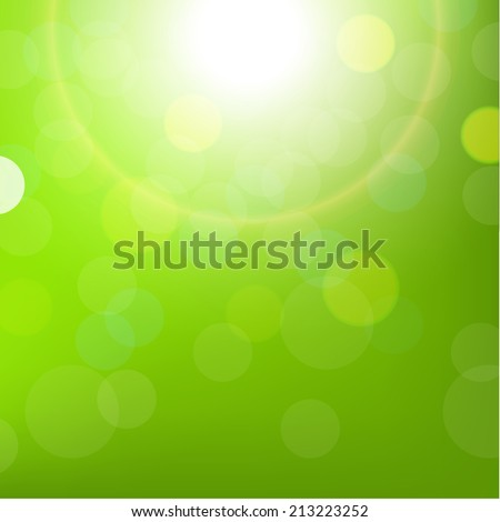 green sun background with bokeh