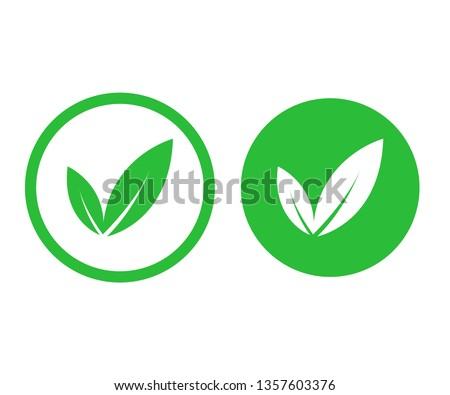 Green vegan logo leafs. Sign of vegetarian. Natural food isolated on white background. EPS 10