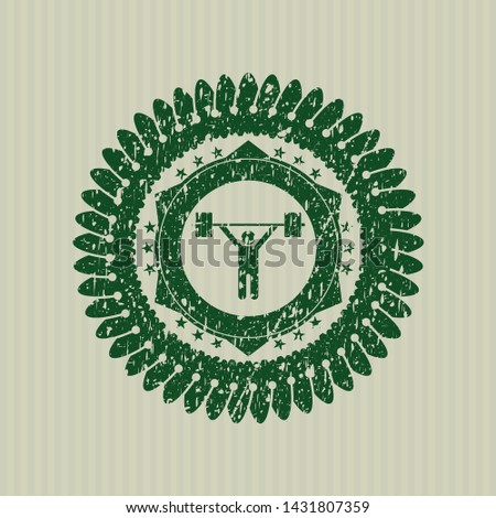 Green weightlifting icon inside distressed rubber grunge texture stamp