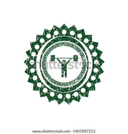 Green weightlifting icon inside rubber grunge texture seal